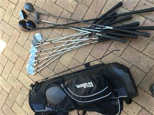 Full set of Wilson golf clubs and woods