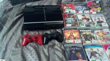 Playstation 3 With 2 Controls and 12 games For sale
