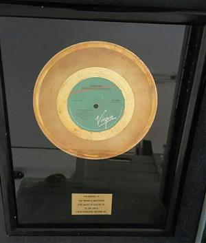 Golden 7' s record award  Presented to The Twinkle Brothers for the regae 7's Jahoviah