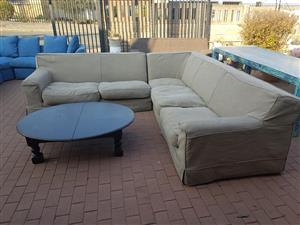 5 Seater beige corner couch with round coffee table