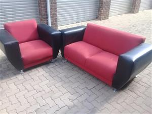 Red and black leather 2 piece lounge suite