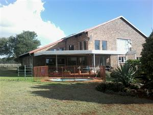 GREAT Plot for sale in Raslouw, Centurion with seperate 2 Bed Loghome - With sheds, workshops and pool! Great for running your business from.