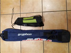 Hockey shinpads and gryphon hockey bag