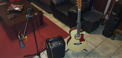 Steel String Acoustic guitar with built in pickup and tuner and Bluetooth Speaker/guitar amp combo