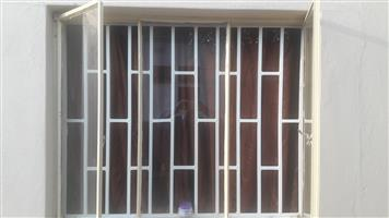 Safety gate and burglar bars