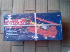 Hidraulic Trolley Jack 2ton, 8.5kg nett eaight, lifting range 135-330mm, easy carry handle, high quality steel. Brand ne in a box.