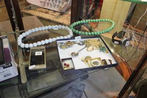 White and green bead necklaces,phone and watch