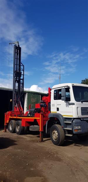 Super rock 3000 water drill on Man truck