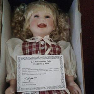 porcelain doll with birth certificate