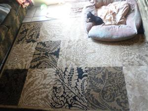 Beige and black carpet for sale