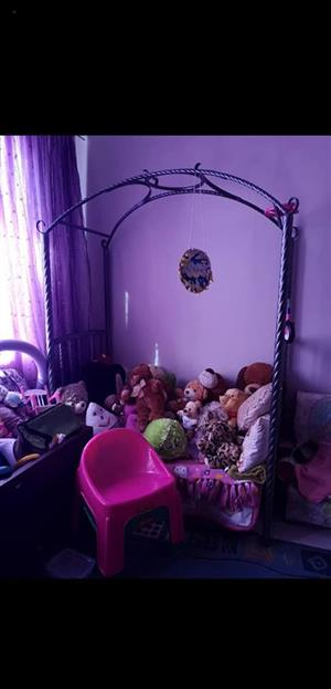 Kiddies framed bed with various teddies