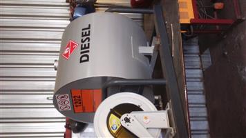 Diesel Tank with pump and hose on reel.
