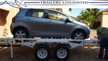 TRAILERS UNLIMITED DOUBLE AXLE CAR TRAILER + WINCH.