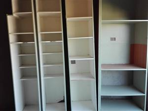 White wooden cupboards with many shelves