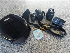 Nikon D3100 camera with accessories