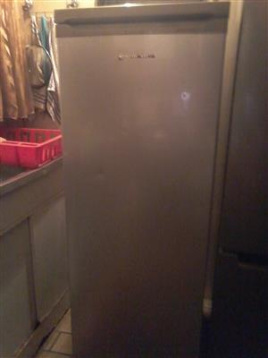 Kelvinator metallic up right freezer in good working condition