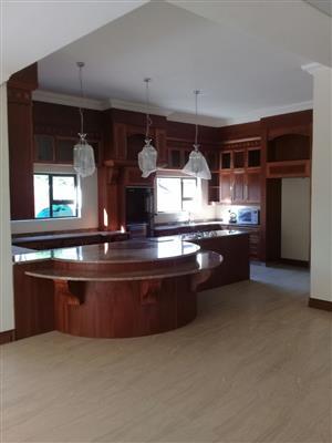 Status Kitchens & Bars manufatory and design kitchens