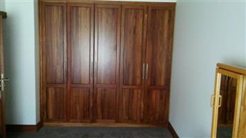 Custom made kitchens, cupboards and other wood furniture