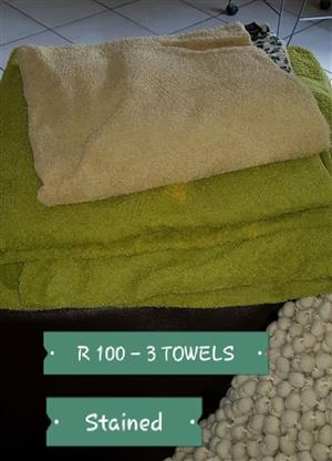 Stained green and beige towels