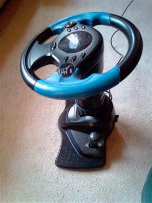 Steering Wheel & Gear Lever for PS2. Adjustable height and angle. No pedals.
