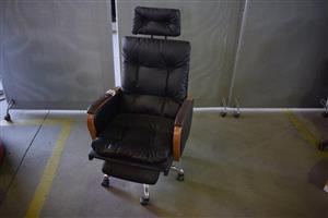 Black leather office chair with wheels and head rest