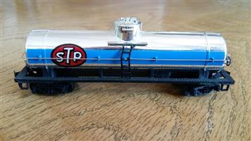 Blue and silver STP model train