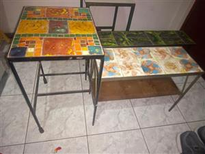 Three beautiful tile top tables for sale.