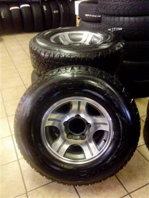 Land cruiser 16 inch rims with 265/75/16 Goodyear Wrangler set for R14000