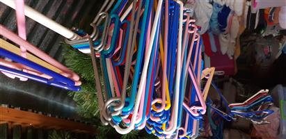 Lots of plastic Coat Hangers