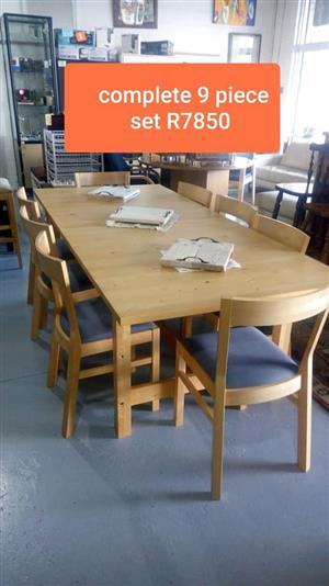 Complete 9 piece light wooden dining set
