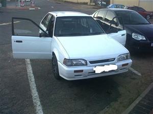 Mazda/ Ford white door