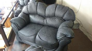 Grey patch 2 seater couch