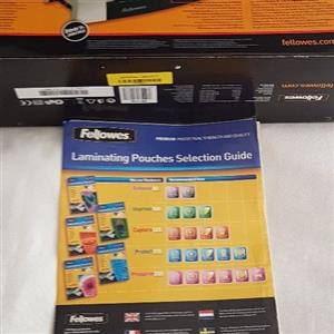Fellowes A4 laminator. New condition. Still boxed. With extra pouches.