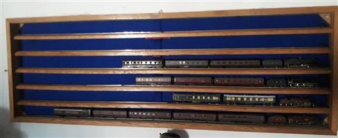 Bespoke American Oak HO model train wall mounted display cabinet, with sliding glass, six courses complete with rails and buffers