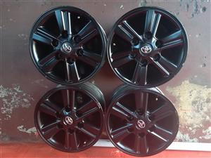 get a set of 15inch Toyota Hilux rims