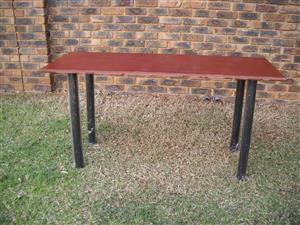 Table with steel legs.