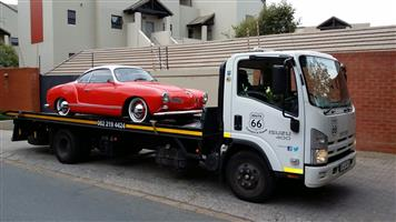 Classic Car transport with flatbed rollback truck