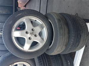 Peugeot mag rims and tyres 155.65R14