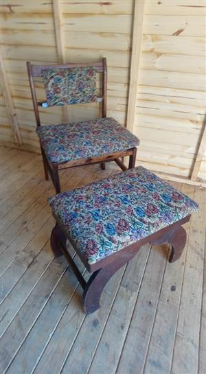Antique wooden chair with foot rest