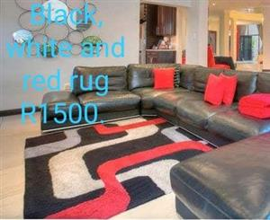 Black,white and red rug for sale