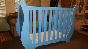 Blue sleigh cot