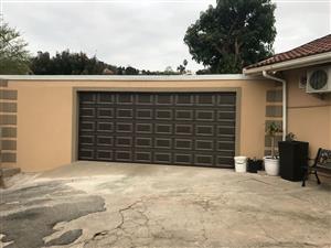 Enkulu Developments - Garage Doors, CCTV, Automation, Control Access, Electric fence.