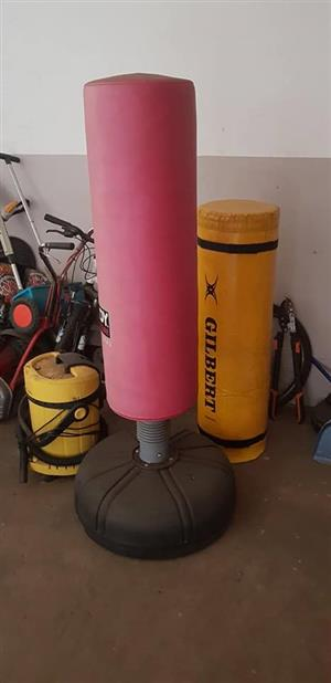 Pink and yellow punching bags