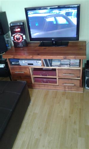 We have this solid wood tv cabinet in mint condition