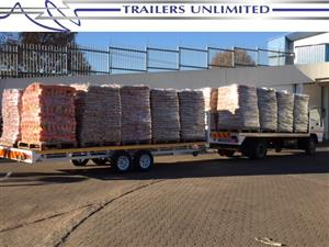 TRAILERS UNLIMITED. THE BIG FLATBED TRAILER.