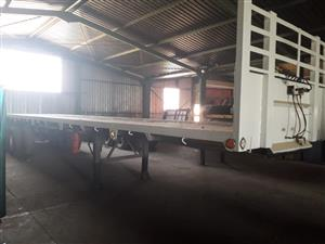 FLAT DECK DOUBLE AXLE TRAILER IN GOOD CONDITION: