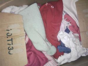 Box full of baby winter clothing