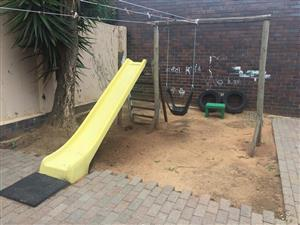 Yellow slide jungle gym for sale