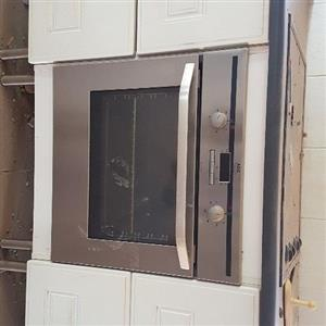 kitchen unit with stove and hob in excellent condition