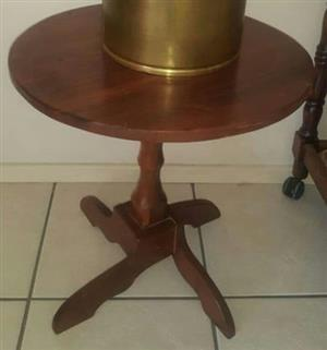 Short wooden round table